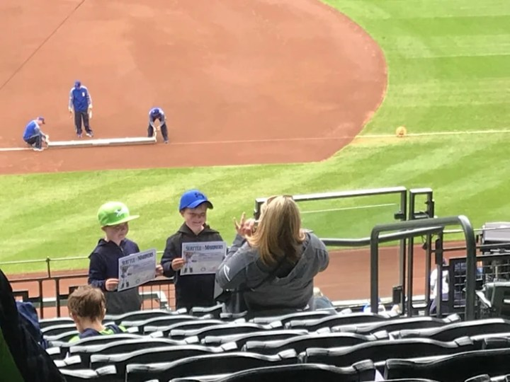 kids getting a free certificate for attending their first mariners game