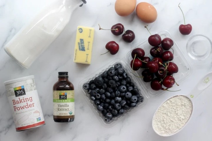 Ingredients for making fresh blueberry and cherry cake bars