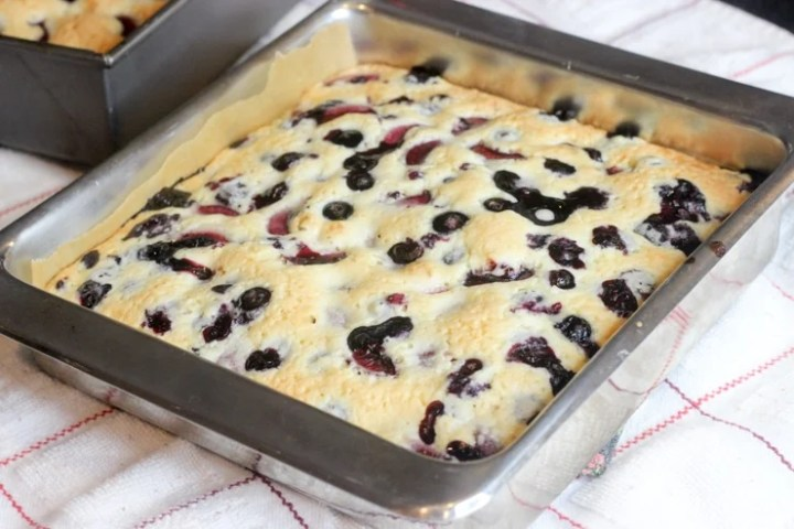 berry cake bars in a pan done cooking