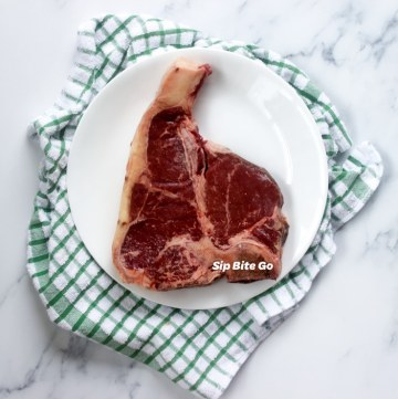 raw t bone steak on a counter