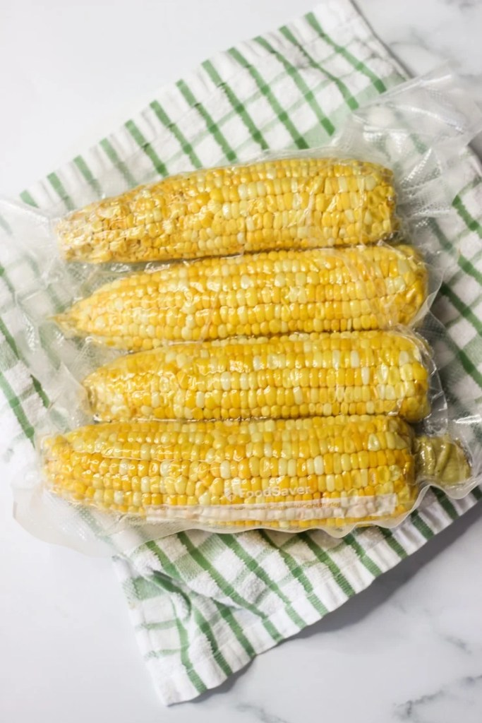 sous vide corn on the cob on a kitchen counter