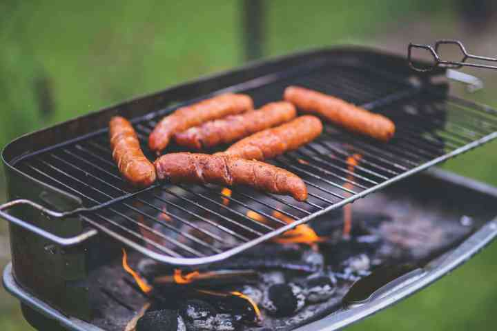 grilling hot dogs on a bbq