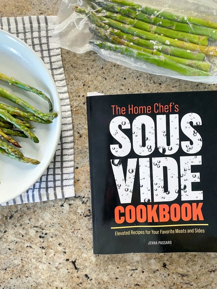 the home chef's sous vide cookbook with sous vide asparagus in vacuum sealed bag