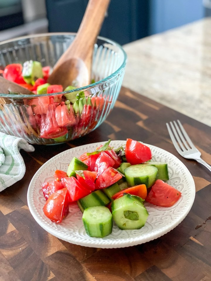 serving salad with tomatoes and cucumbers