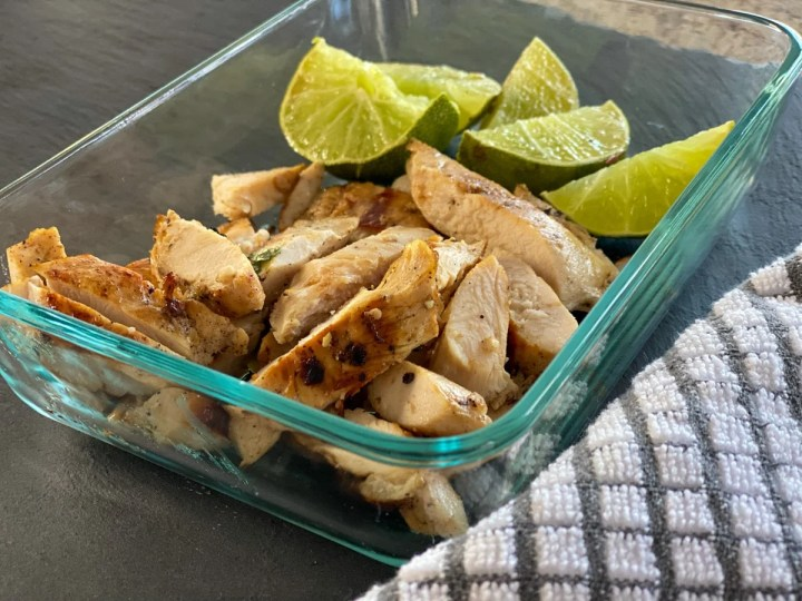 sous vide chicken cooked tender with limes in a meal prep container