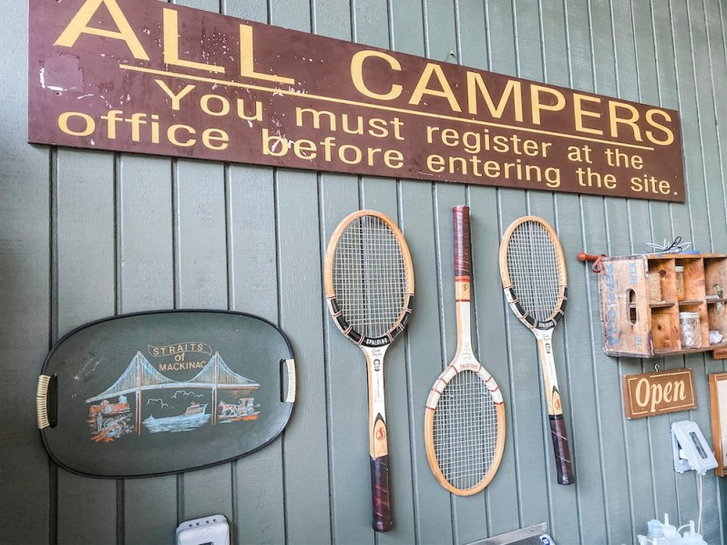 Vintage Camping Items Hanging on Wall
