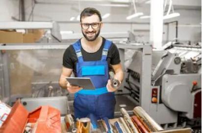 Worker in metal stamping factory