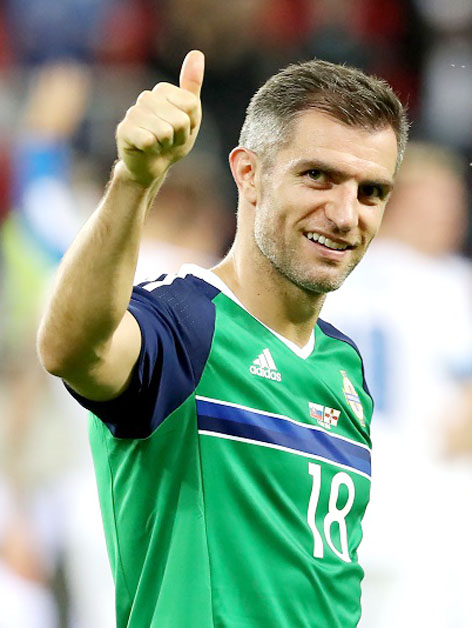 Press Eye - Belfast -  Northern Ireland - 04th June 2016 - Photo by William Cherry Northern Ireland's Aaron Hughes gets his 100th cap against Slovakia during Saturdays International Friendly at the City Arena, Trnava. The game friendly is Northern Ireland's final warm-up game before travelling to their Euro 2016 base camp in France.