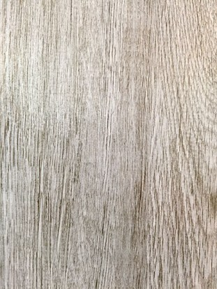 The beautiful plank tile floor with the cool grey wood look.