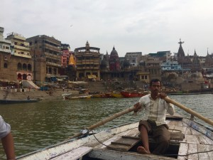 Our kind boat driver in front of the main burning ghat, Manikarnika Ghat