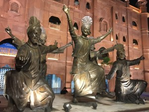 A statue showing Bhangra, a traditional Punjabi dance