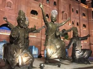 A statue showing Bhangra, a traditional Punjabi dance