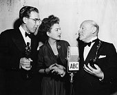 Actor Edmund Gwenn (right) and writer George Seaton (left) holding their Oscars for the film 'Miracle on 34th Street', with presenter Anne Baxter, at the 20th Academy Awards, Los Angeles, March 20th 1948. (Photo by Archive Photos/Getty Images)