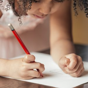 girl drawing on paper