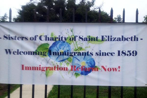 SCNJ-immigration-sign