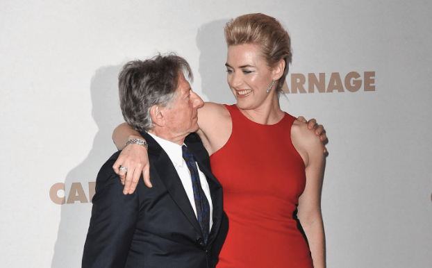 Kate Winslet putting her arm around Roman Polanski on the red carpet.