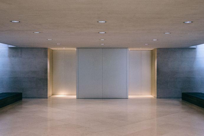 A modern elevator in an empty hall.