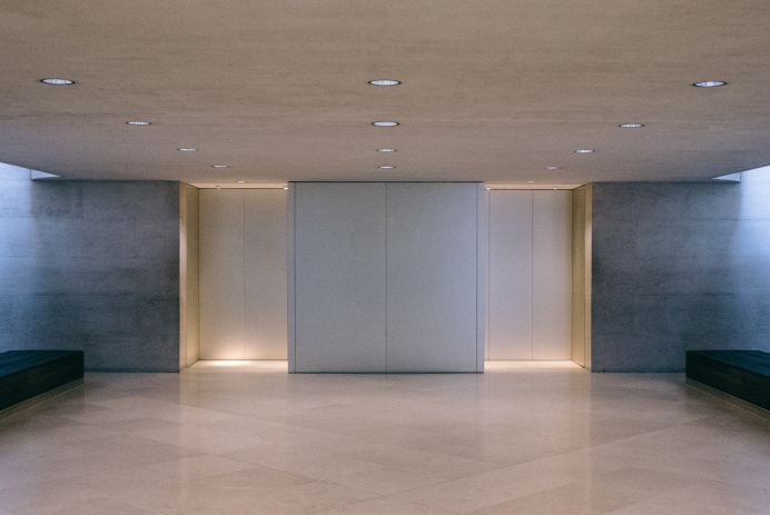 A modern elevator in an empty hall.