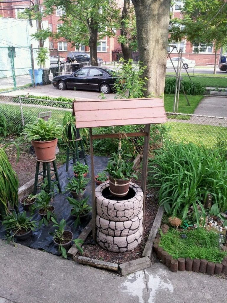 Build A Wishing Well Planter From Recycled Tires