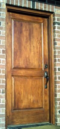 Metal doors woodgrained to match real wood doors
