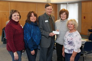 to right, Pam Bruni and Vicki Nycum, past presidents of the Woman's Club; Jim Swanson, CC director of financial aid; Diane Bell, Woman's Club current president; and Karen Rubinow, Woman's Club incoming president.