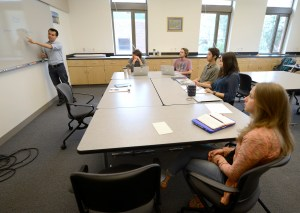 Kevin Holmes, professor of psychology, meets with his team of summer student researchers at a weekly collaborative meeting.