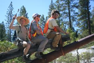 Left to right: Edward Crawford, Andrew Gregovich, and Will Durrett apply their climbing skills on a piece of historic hydraulic mining equipment at Malakoff Diggins, California.