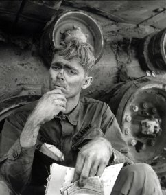An American soldier reading a letter from home, Lang Vei, South Vietnam, 1971