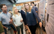 Hannah Rider '19 explains her summer research to her parents during the SCORE Symposium at Cornerstone Arts Center. The symposium was held during Family and Friends Weekend.