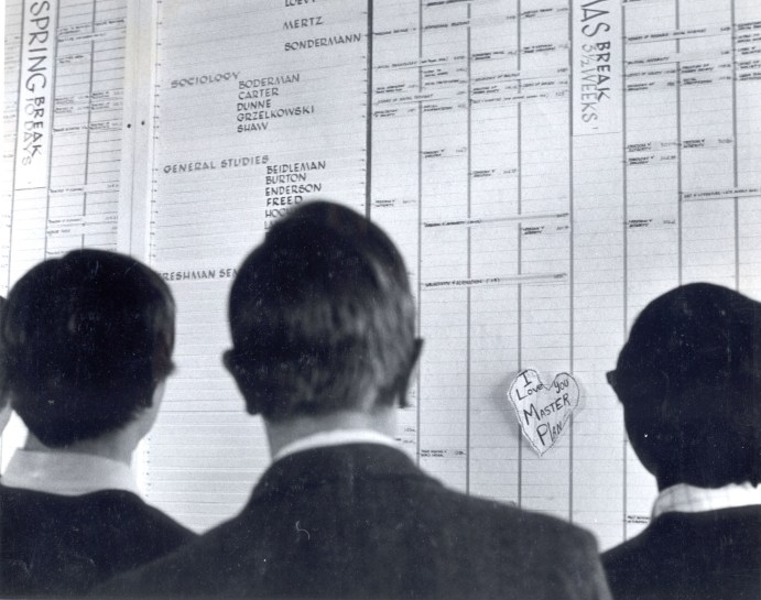 CC students study the 1970-71 class schedule on one of four 8-foot panels in Rastall Student Center.
