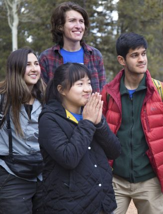 CC students Olivia Martinez '20, Daniel Allen '20, Nathan Agarwal '19, and Aiyu Zheng '18 watch as students drive away on the last day of TREE Semester at the Catamount Center.