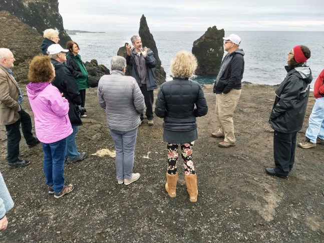 Professor Jeff Noblett describing how the group was standing where the mid-Atlantic Ridge rises onto land.