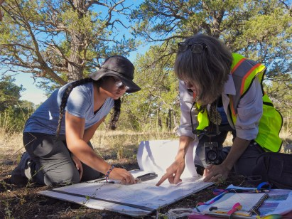 Lily Tejeda-Barillas '21, left, and professional archaeologist Marilyn Martorano plot sampled trees at an archaeological site near Crestone. Students gained experience in archaeological methods such as survey, metal detection, dendrochronology, and excavation.