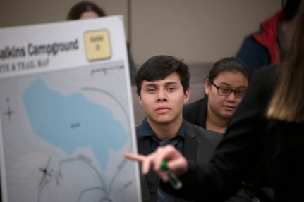 Bryan Moreno, freshman, watches the defense utilize a demonstrative during a mock trial practice on Tuesday, February 18, 2020 at the El Paso County Combined Courts. Colorado College hosts the regional mock trial tournament this weekend. (Photo by Katie Klann)