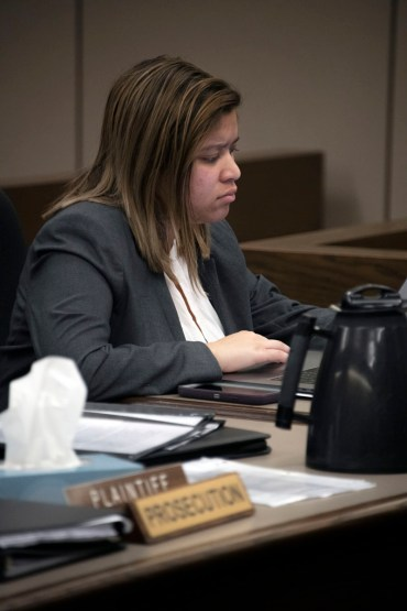 Taylor Hawkins, junior, takes notes during a mock trial practice on Tuesday, February 18, 2020 at the El Paso County Combined Courts. Colorado College hosts the regional mock trial tournament this weekend. (Photo by Katie Klann)