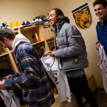 Cooxooeii Black, center, reacts to the new men's basketball jerseys on Friday, February 7, 2020 at El Pomar Sports Center in Colorado Springs, Colorado. (Photo by Katie Klann)