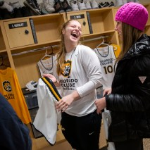 Izzy Hensley, left, and Tedy Reed react to their new uniforms on Friday, February 7, 2020 at El Pomar Sports Center in Colorado Springs, Colorado. (Photo by Katie Klann)