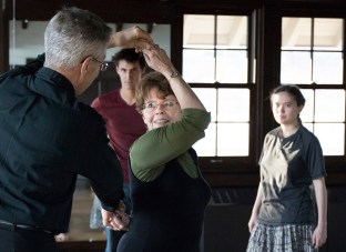 Marcia Dobson and J.L. Riker teach a ballroom dancing class in Cossett Hall that is open to students and staff alike. The class focuses on dance techniques for various dance styles. Soren Kodak and Greta Wu watch a technique being demonstrated. (Photo by Jennifer Coombes)