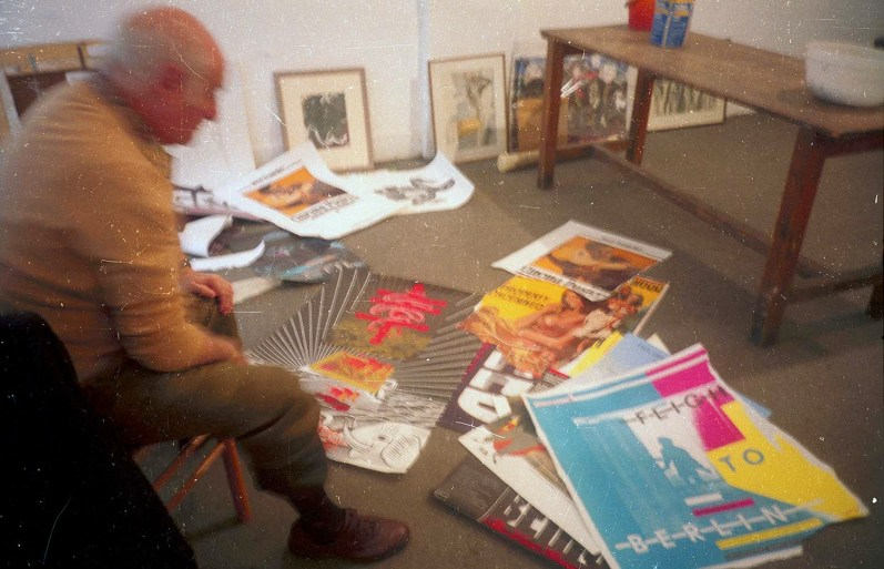 1990. Mimmo Rotella making a collage. RDG, Edinburgh.