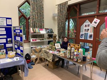 Staff member of Eco Bricks sitting at their stall