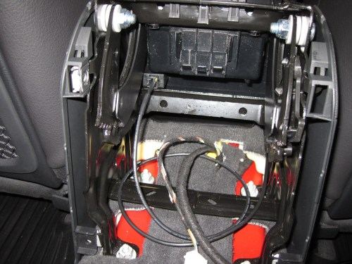 small resolution of view of audio cable as it clears the front ashtray assembly to the right