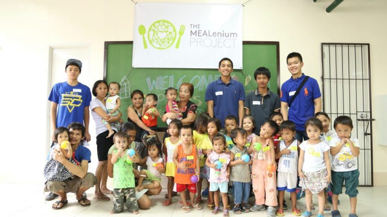 The MEALenium Project core team members, Basti Belmonte (Co-Founder), Javi Amador, Michael Singson and Joshua Tan (Co-Founder) with the kids of St. Benedict, Payatas.