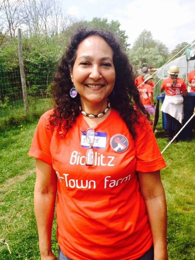 Professor Ivette Perfecto outside wearing a D-Town Farm shirt.