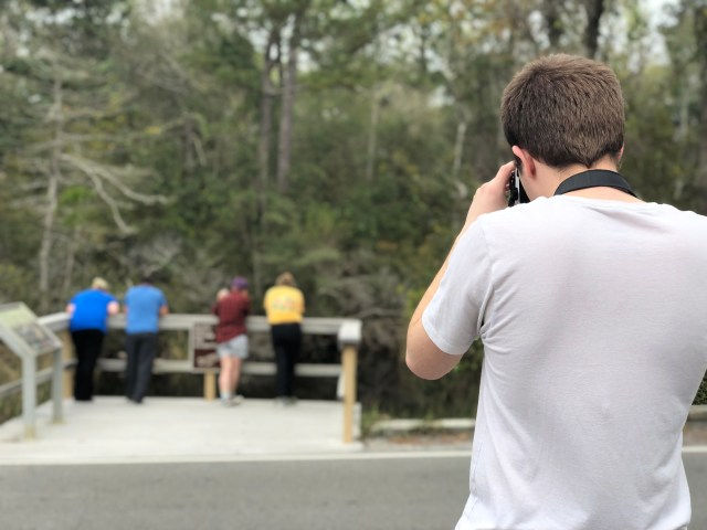 Spencer Bowman takes a photo of some park tourists.