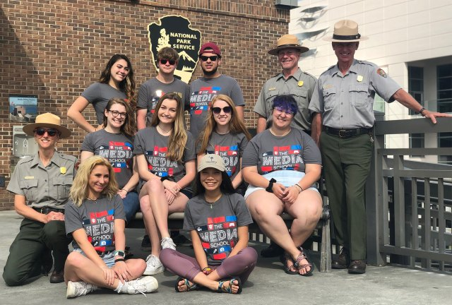 The alternative summer break group poses with park rangers in front of Fort Sumter national monument.