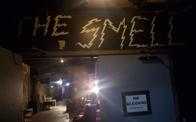 "The inside of The Smell music venue. There's a poster that says ""No Alcohol inside or out."""