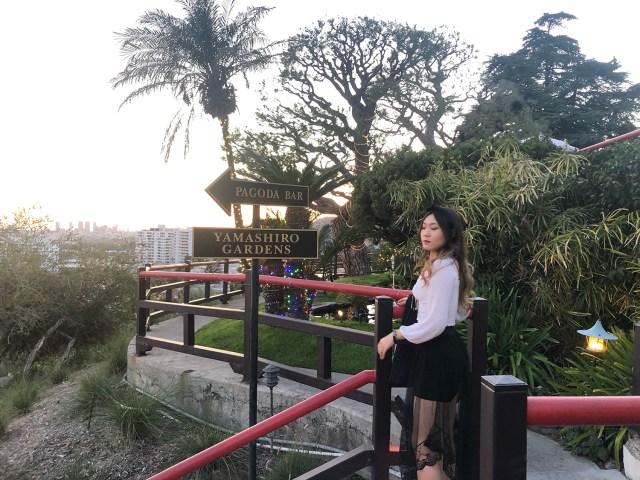 Sara Sun standing at the top of a hill at Yamashiro Gardens