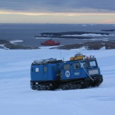 Sampling on station with Aurora Australis in background