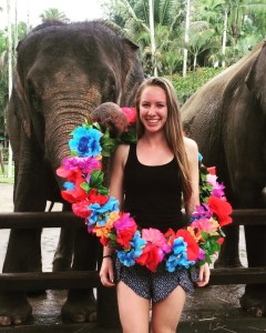 Pose with elephant and leis