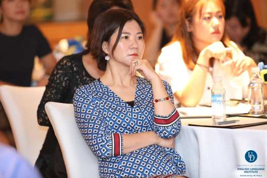 A guest at the ELI 40 alumni event in Shanghai listens during an information session.